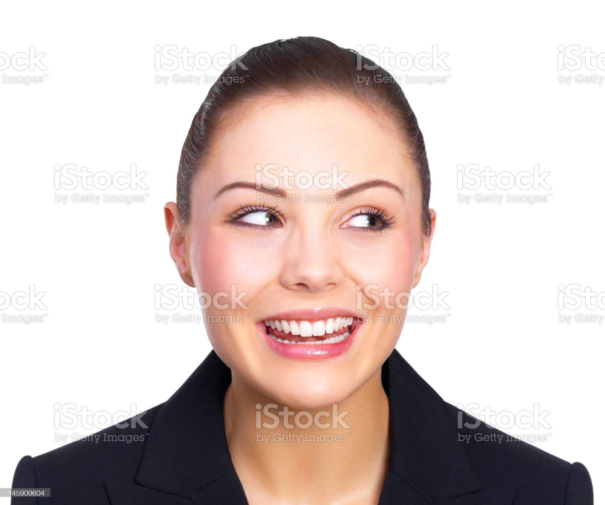 Close-up of a young woman looking sideways and smiling royalty-free stock photo