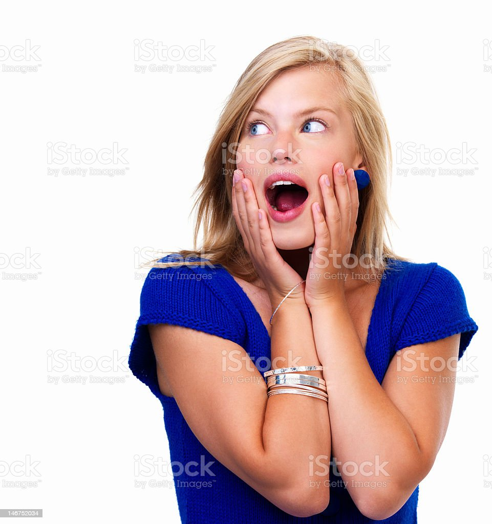Close-up of a young woman looking surprised on white background royalty-free stock photo