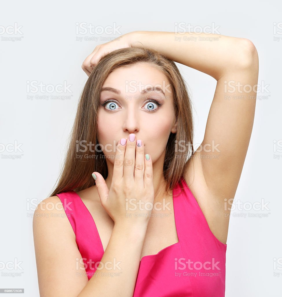 Close-up of a young woman looking surprised stock photo
