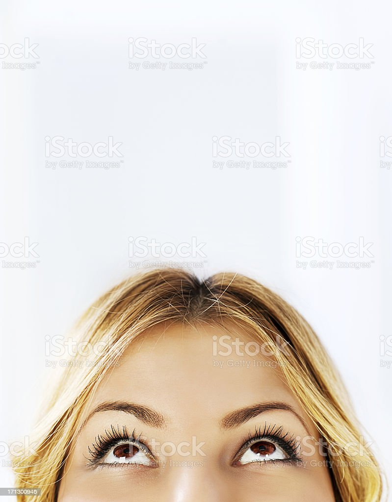 Close-up of a young woman looking up stock photo