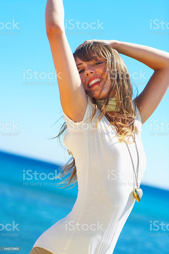 Close-up of a young woman posing on the beach royalty-free stock photo