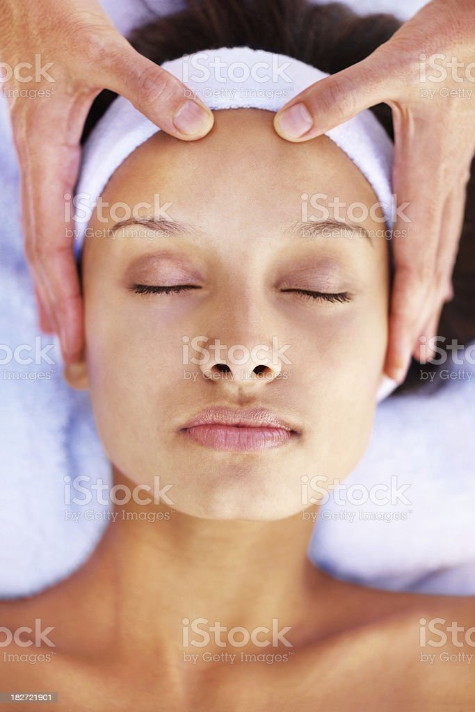 Closeup of a young woman receiving facial treatment royalty-free stock photo