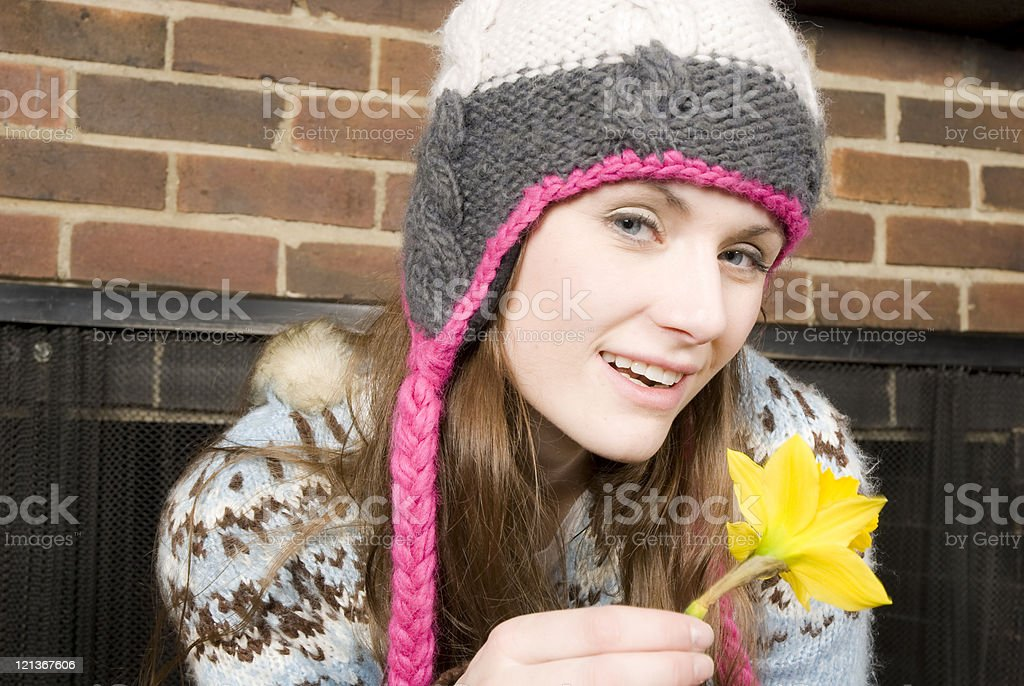 Close-up of a young woman smelling flower stock photo