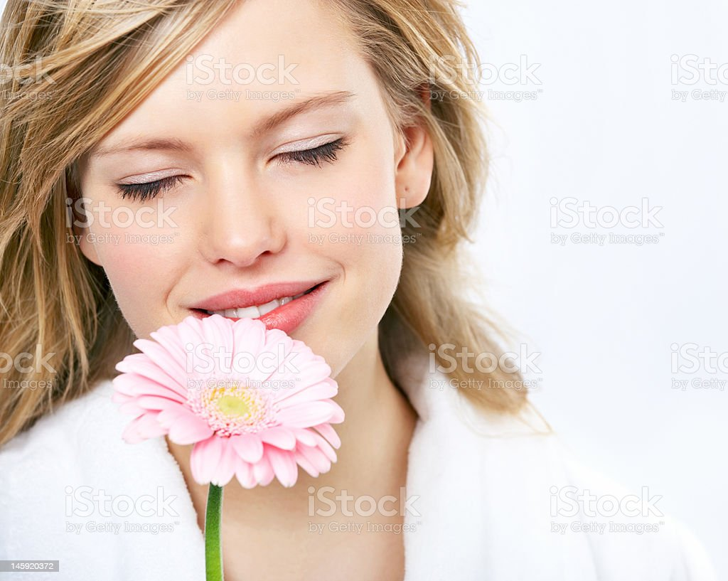Close-up of a young woman smelling flower royalty-free stock photo