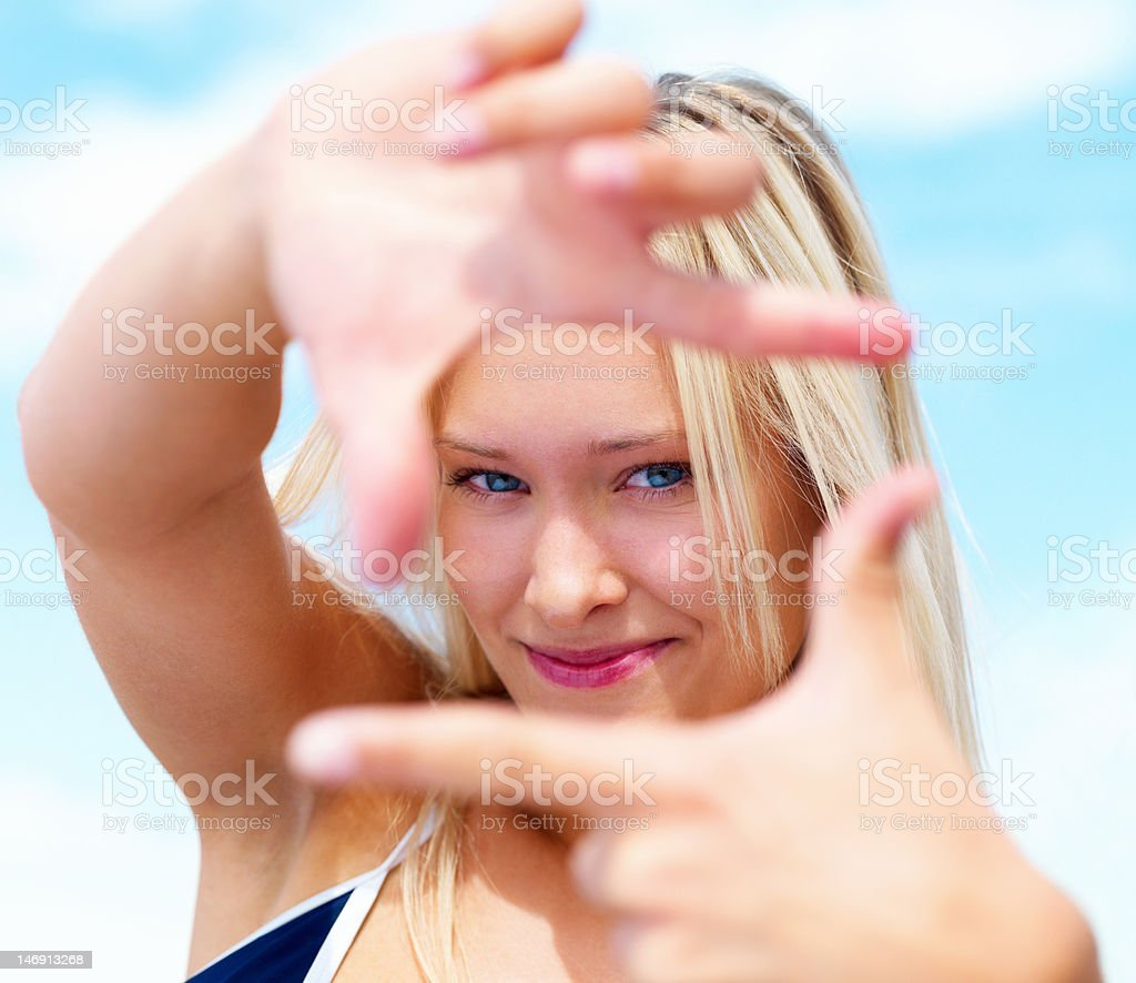 Close-up of a young woman smiling and gesturing royalty-free stock photo