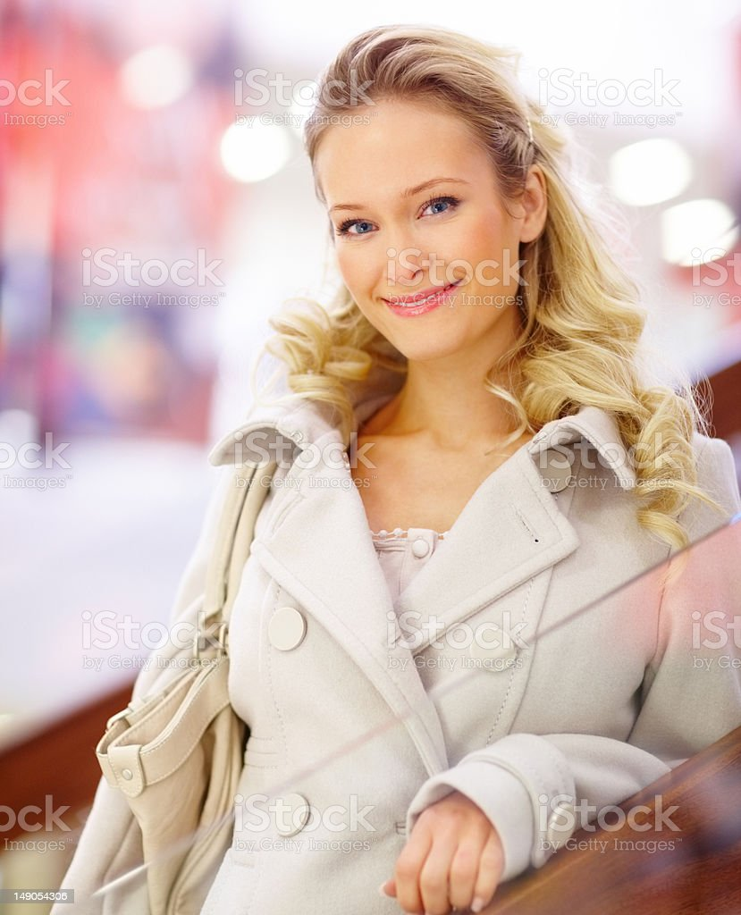 Close-up of a young woman smiling in mall royalty-free stock photo