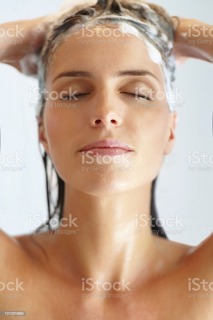 Close-up of a young woman washing hair stock photo