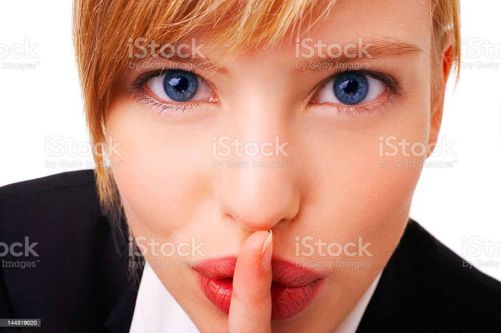 Close-up of a young woman with her finger on lips royalty-free stock photo