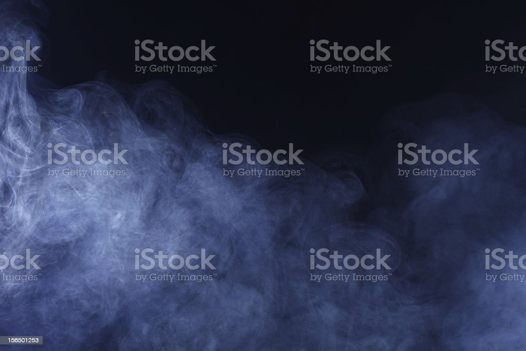 Close-up of abstract ethereal smoke on black background stock photo