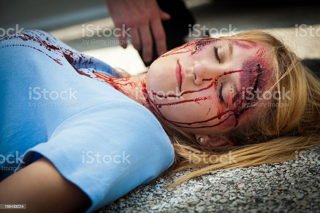 Closeup of accident victim laying on pavement stock photo