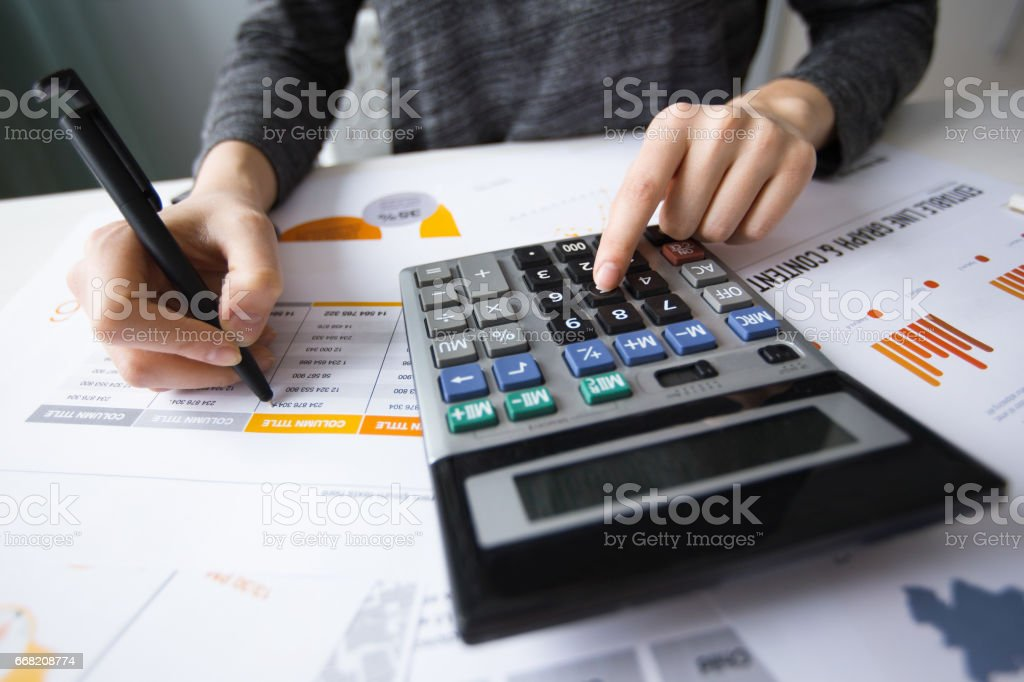 Closeup of Accountant Hands Using Calculator stock photo