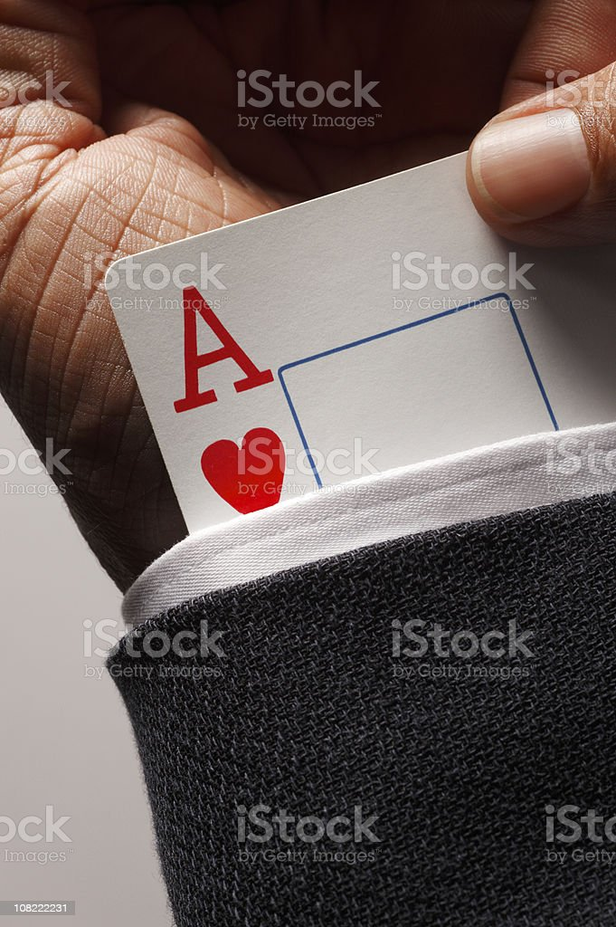 Close-up of Ace Up Businessman's Suit Cuff royalty-free stock photo
