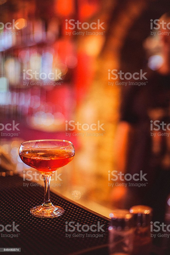 Close-up of alcohol cocktail on the bar counter in nightclub stock photo