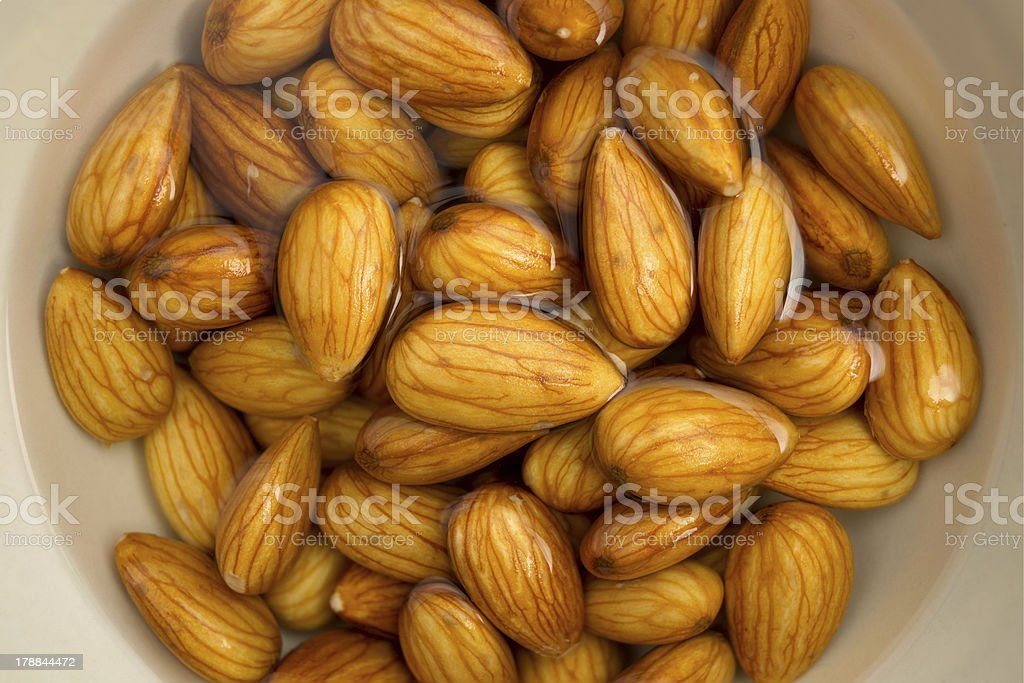 Closeup of almonds soaked in water royalty-free stock photo