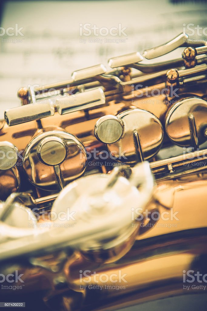Close-up of Alto Saxophone on Music Sheet stock photo