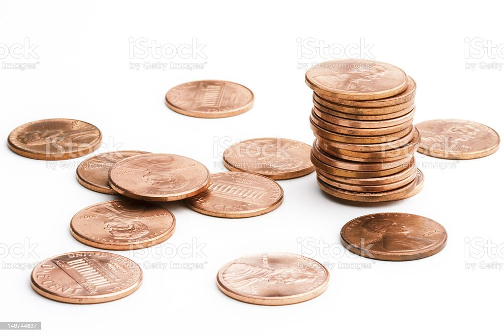 A close-up of American pennies on a white background stock photo