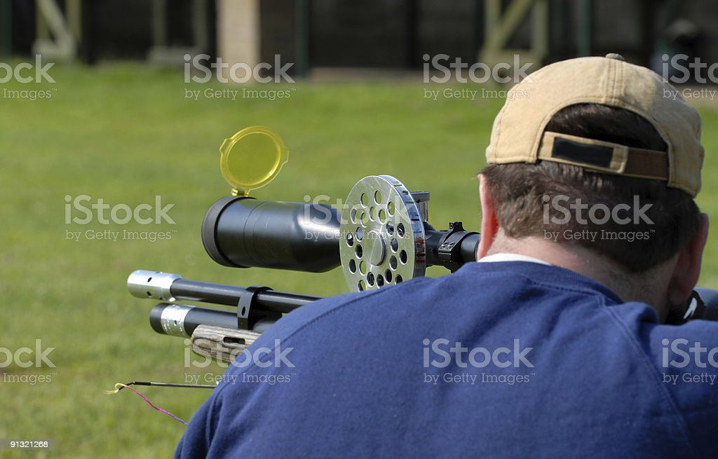 Close-up of an air gunner taking a shot royalty-free stock photo