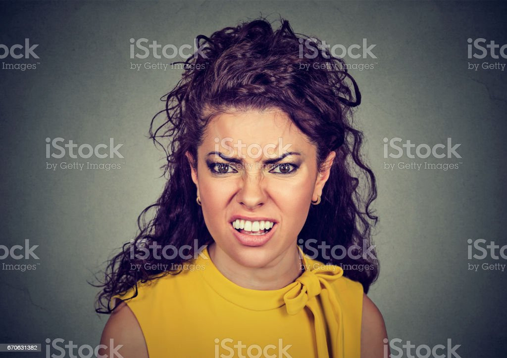 Closeup of an angry furious woman stock photo