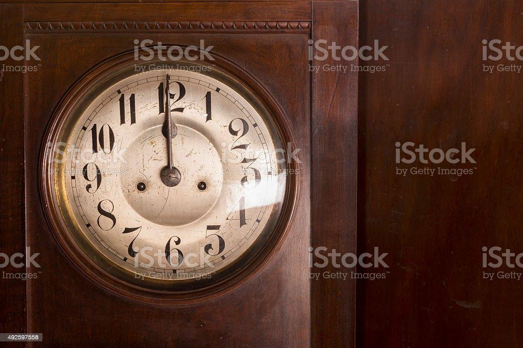 Closeup of an antique pendulum clock stock photo