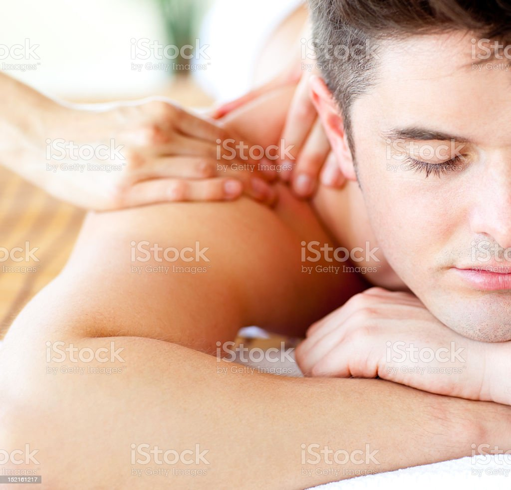 Close-up of an attractive man having a back massage stock photo