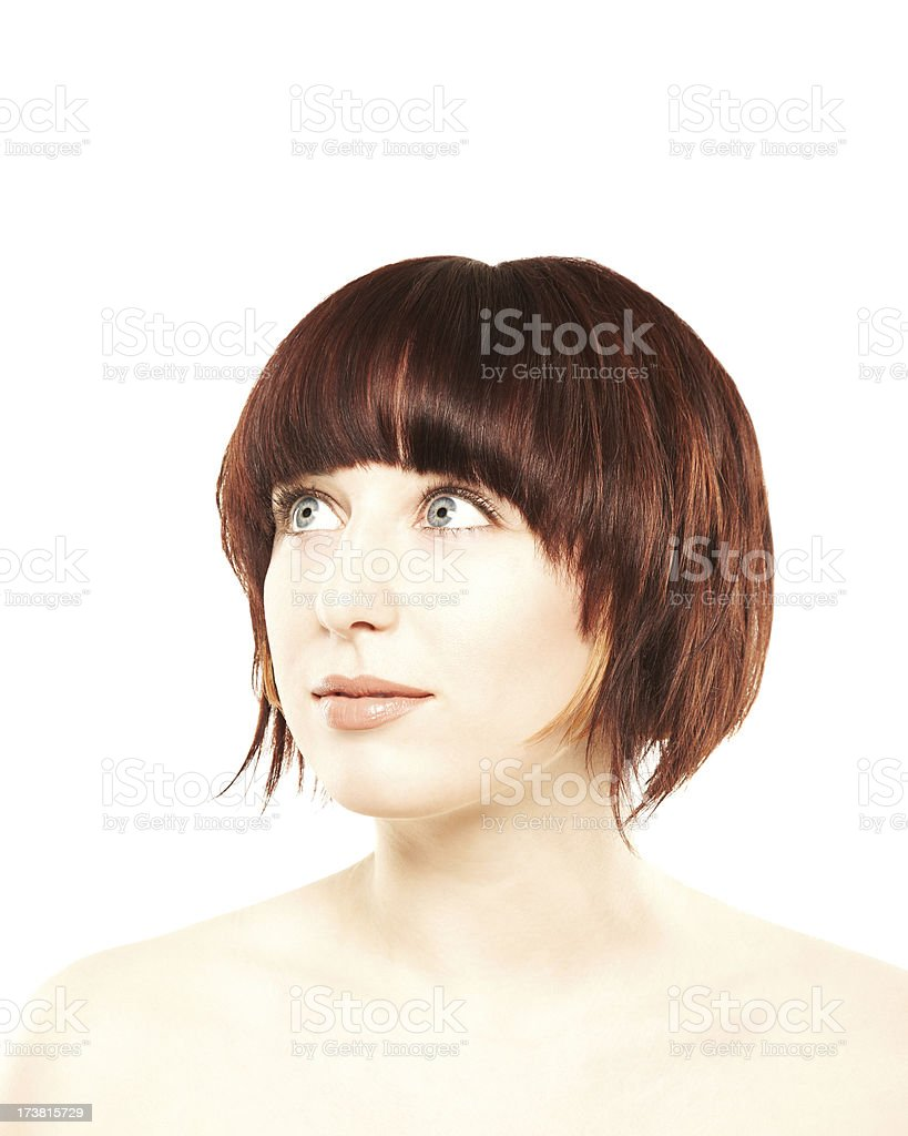 Close-up of an attractive, pensive woman with grey eyes royalty-free stock photo