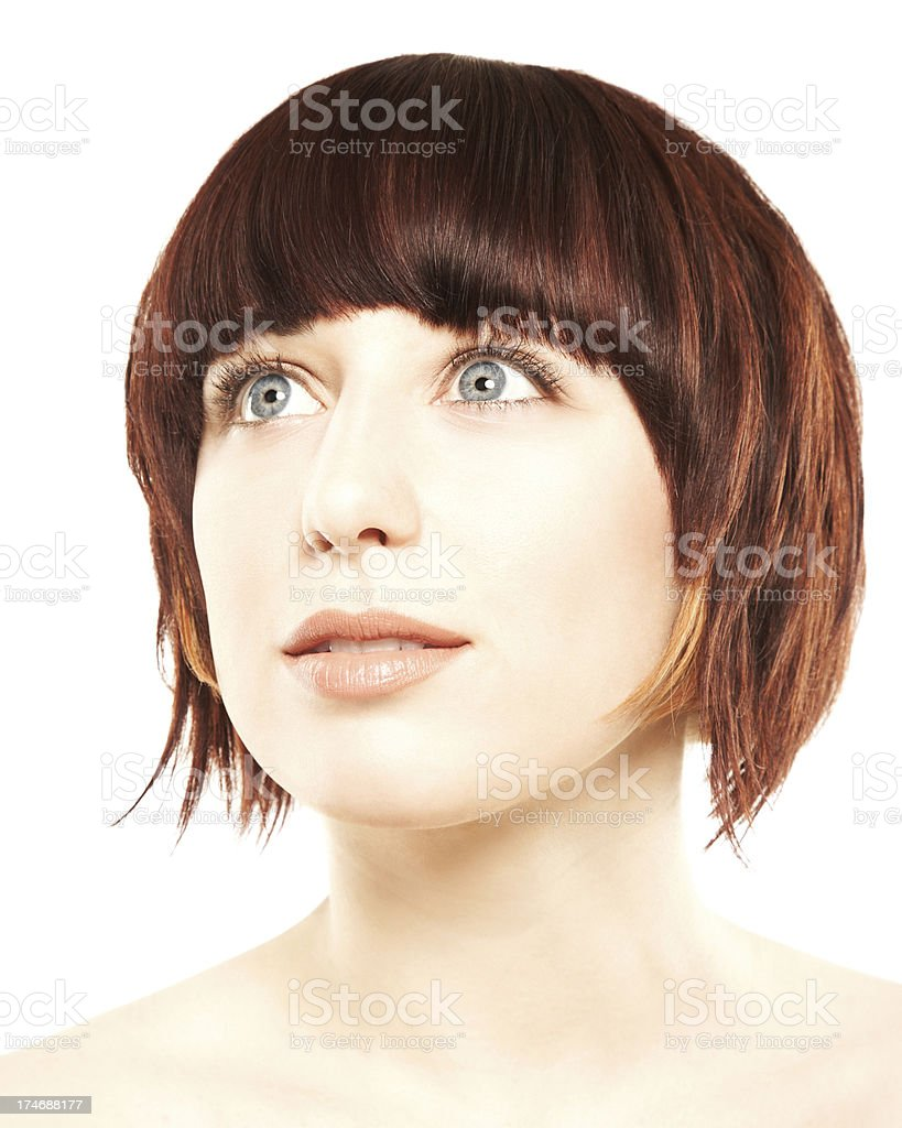 Close-up of an attractive woman with grey eyes contemplating royalty-free stock photo