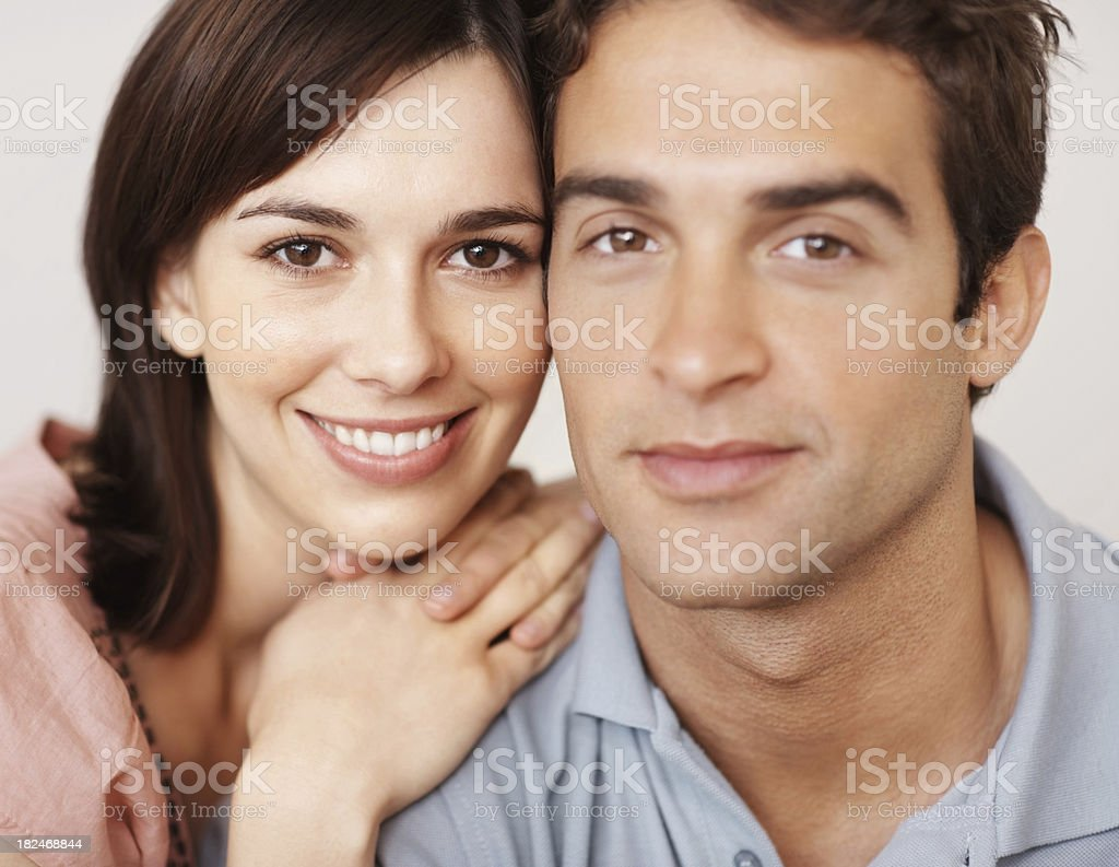 Closeup of an Attractive young couple looking at you royalty-free stock photo