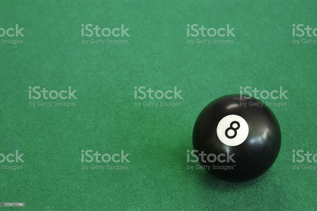 Close-up of an eight ball on pool table stock photo
