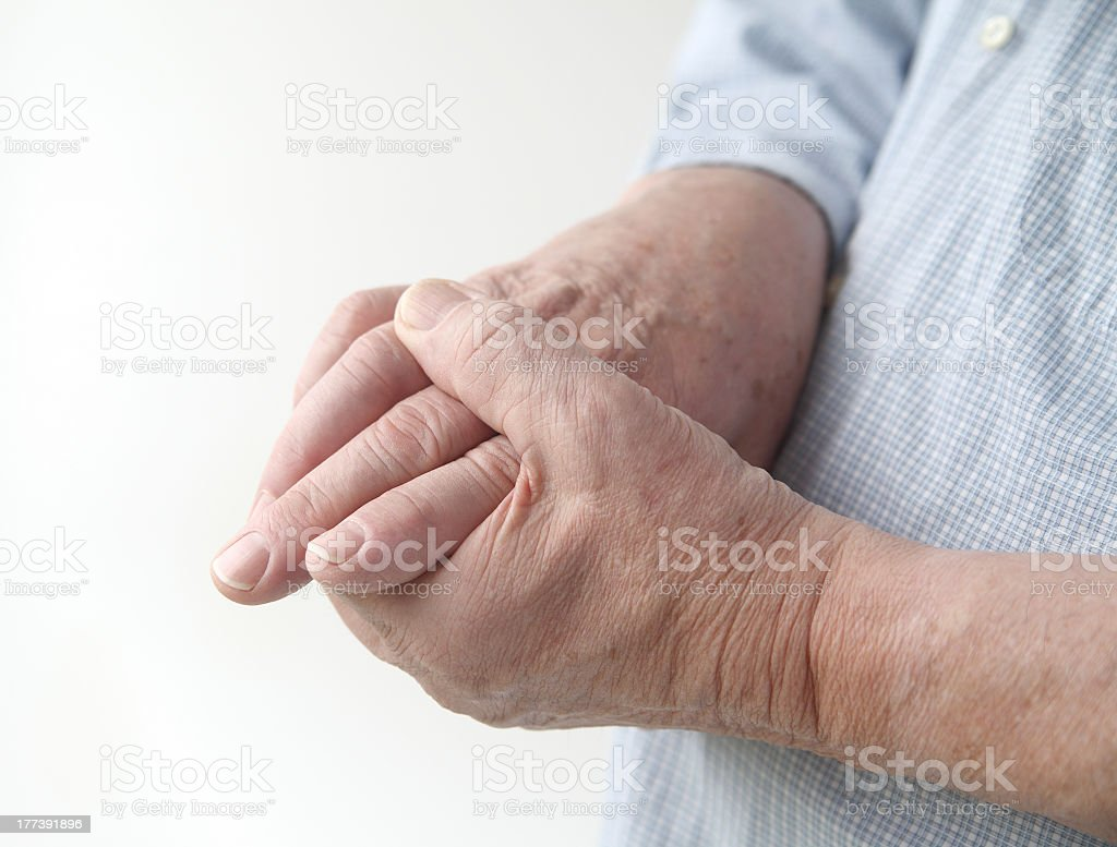 Close-up of an elderly person's hands with joint pain stock photo