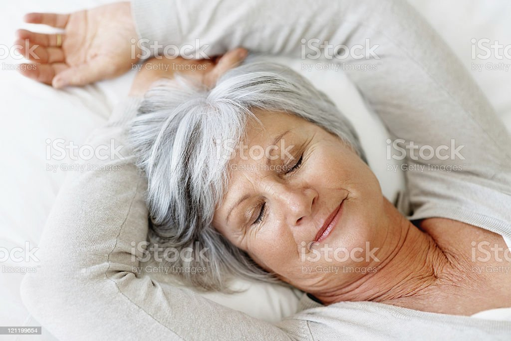 Closeup of an elderly woman fast asleep in bed royalty-free stock photo