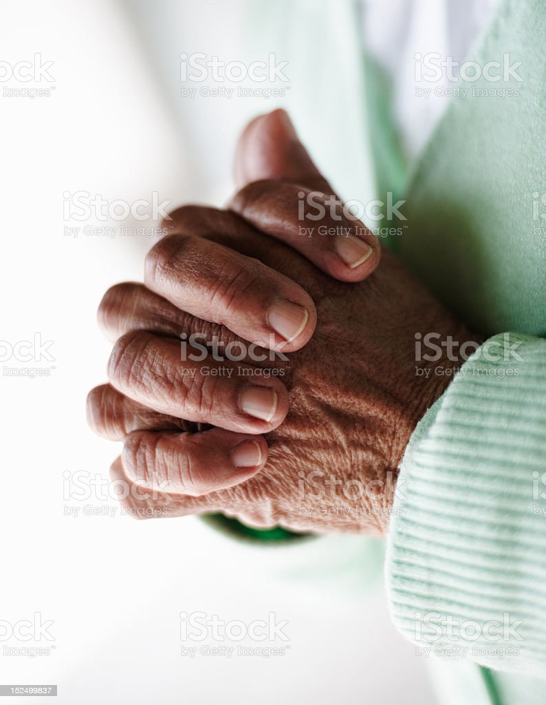 Close-up of an elderly woman's hand joined together royalty-free stock photo