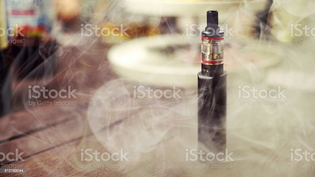 Close-Up of an Electronic Cigarette/E-Cigarette in smoke stock photo