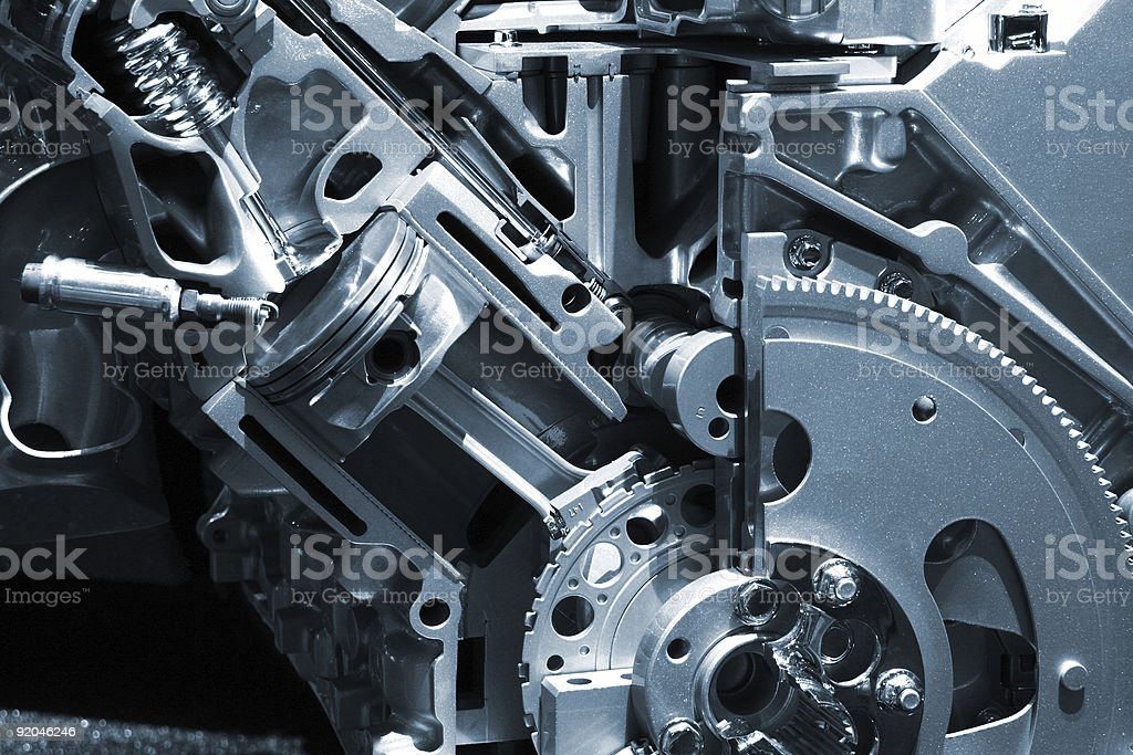 Closeup of an engine with shiny metal parts stock photo