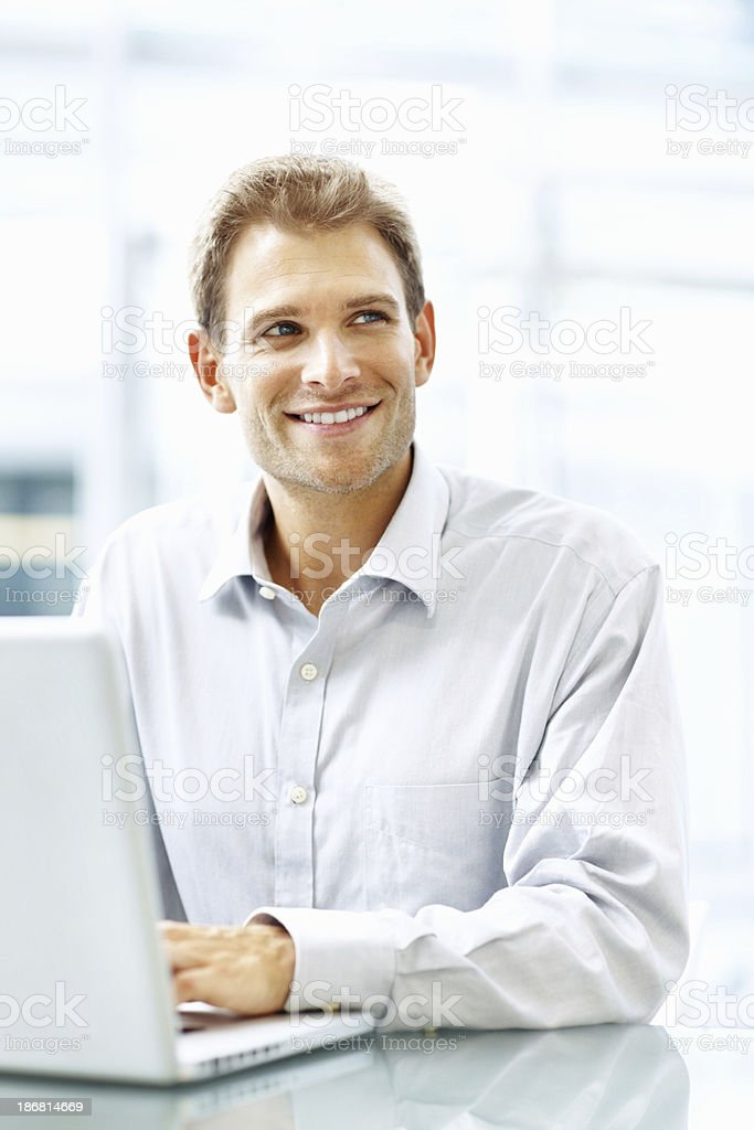 Closeup of an executive working and smiling royalty-free stock photo