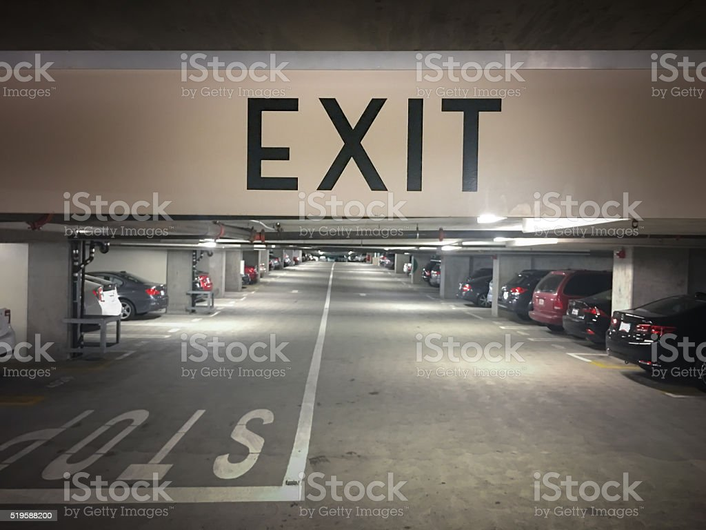 Close-up of an exit sign in underground parking stock photo
