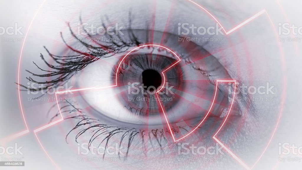 Close-up of an eye with technical security graphic overlay stock photo