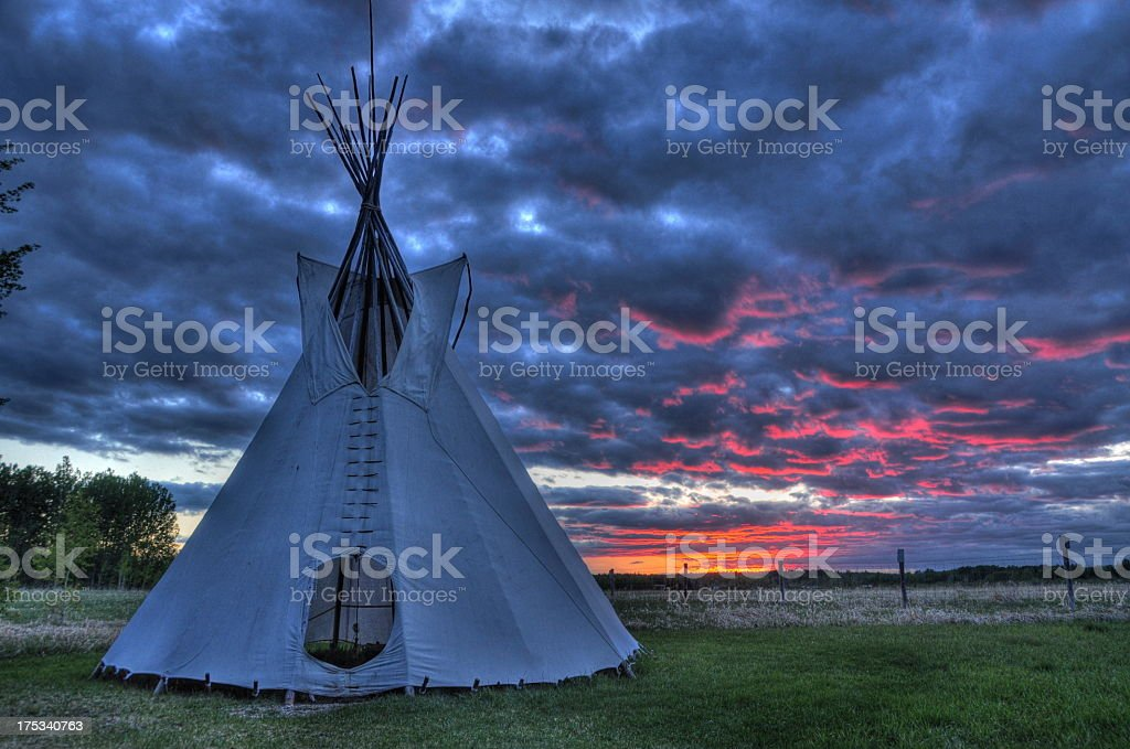 Close-up of an Indian tipi on a field at sunset stock photo