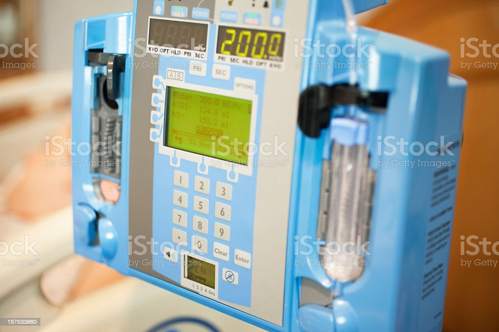 Close-up of an intravenous drip pump inside a hospital room stock photo