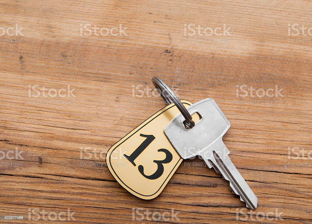 Closeup of an key of room number 13 with key stock photo