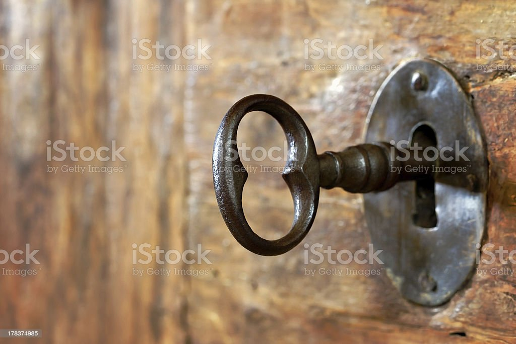Closeup of an old keyhole with key stock photo