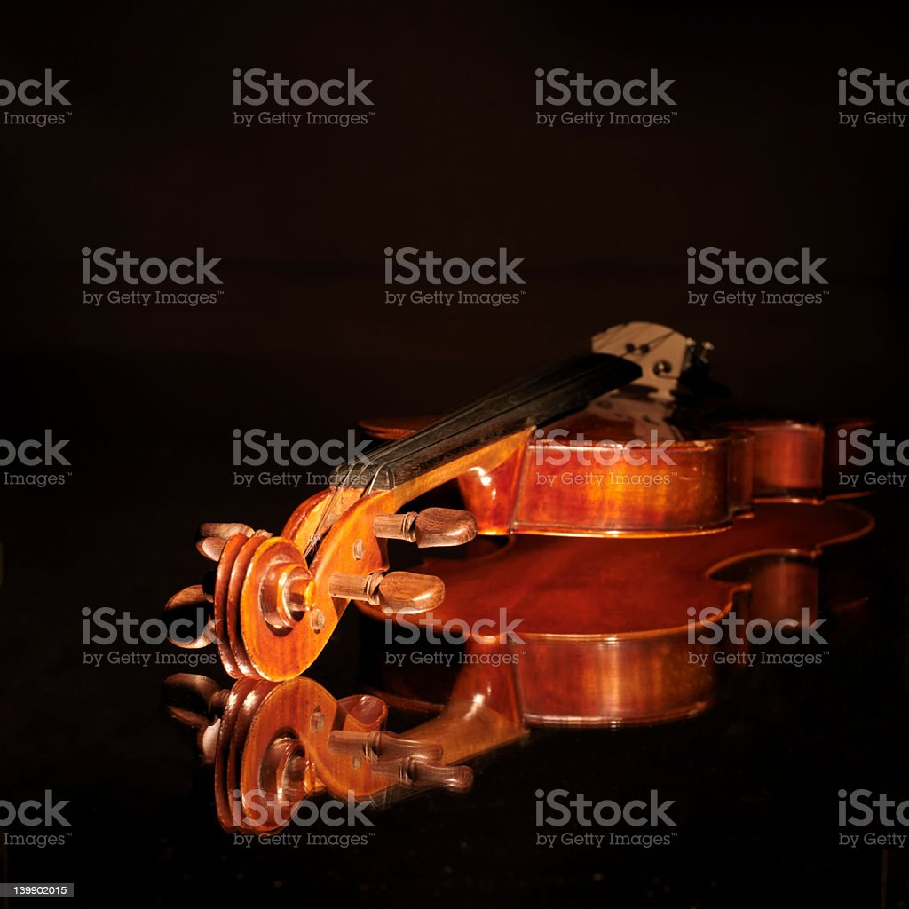 Close-up of an old violin and it's reflection royalty-free stock photo