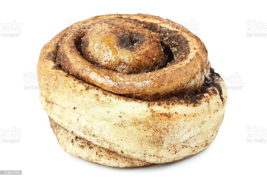 Close-up of an unfrosted sweet bun with cinnamon on white stock photo