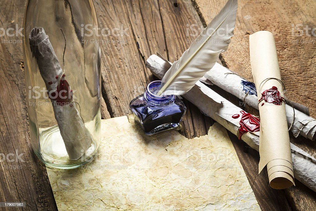 Closeup of ancient scrolls written with ink and feather bird royalty-free stock photo