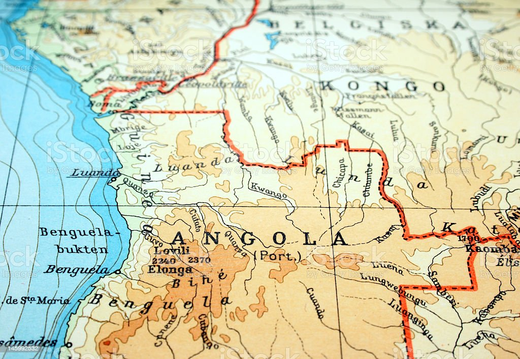 Close-up of Angola on flat paper map stock photo