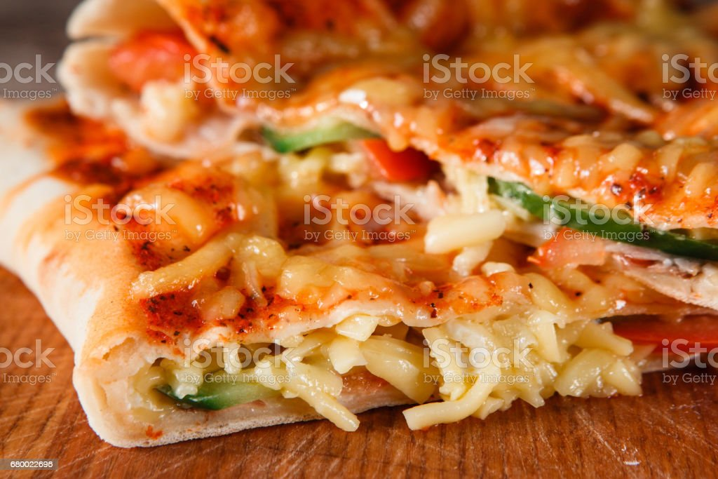 Closeup of appetizing hot pizza calzone slices stock photo