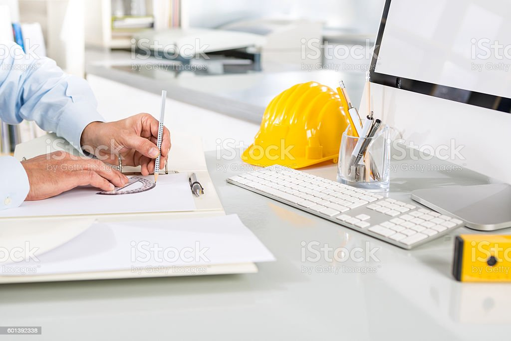 Close-up Of Architect Hands Drawing Sketches stock photo