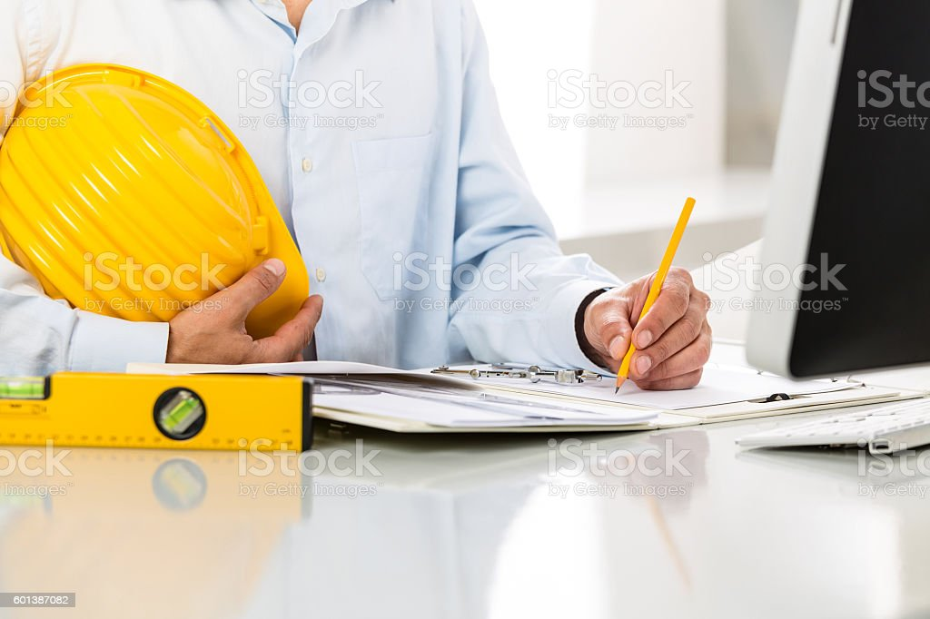 Close-up Of Architect Hands Using Metal Drawing Compass stock photo