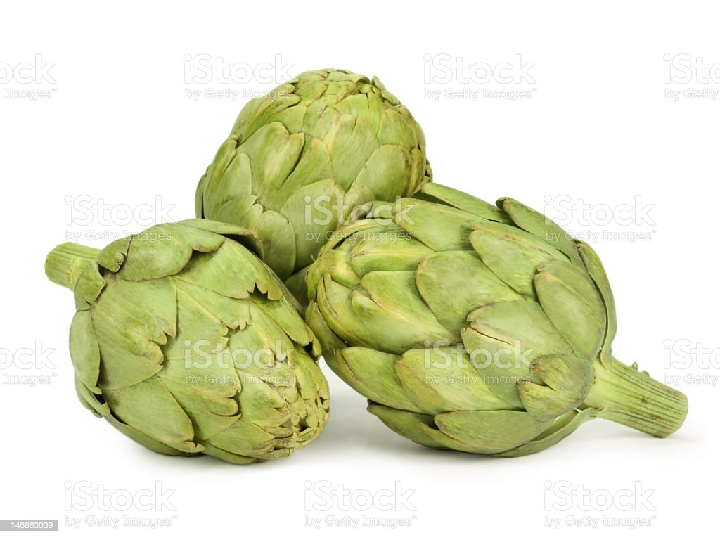 Close-up of artichokes against white background stock photo