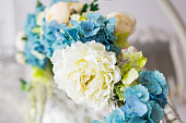 Closeup of artificial flowers blue-yellow-green colors