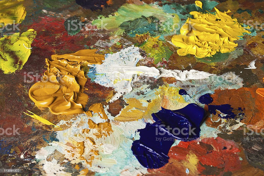 closeup of artists palette with mixed oil paint stock photo